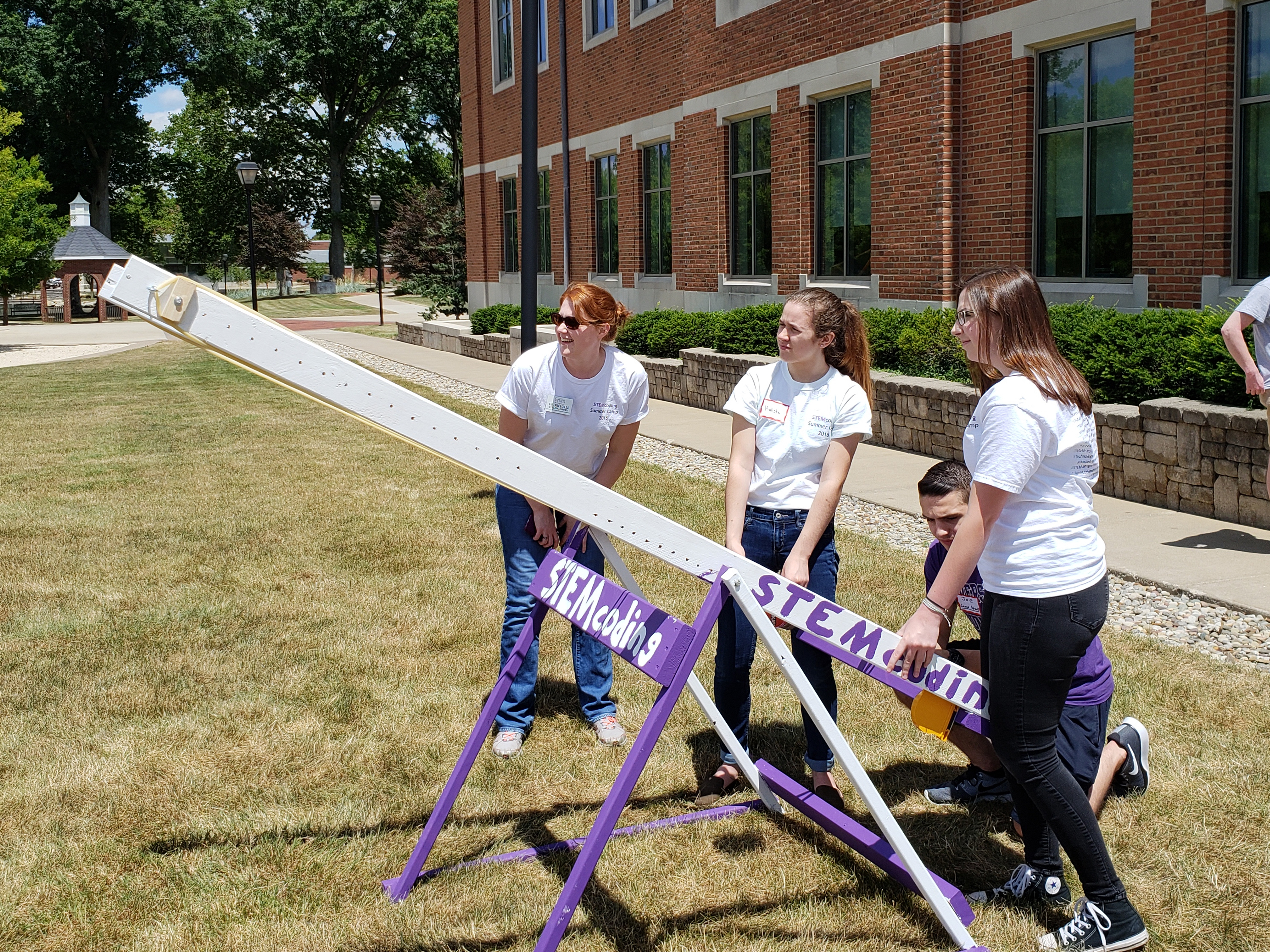 Stemcoding students participate in an experiment with Mount Union faculty member.