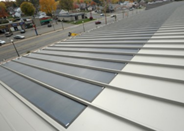 Solar panels cover a portion of the roof on the McPherson Field house