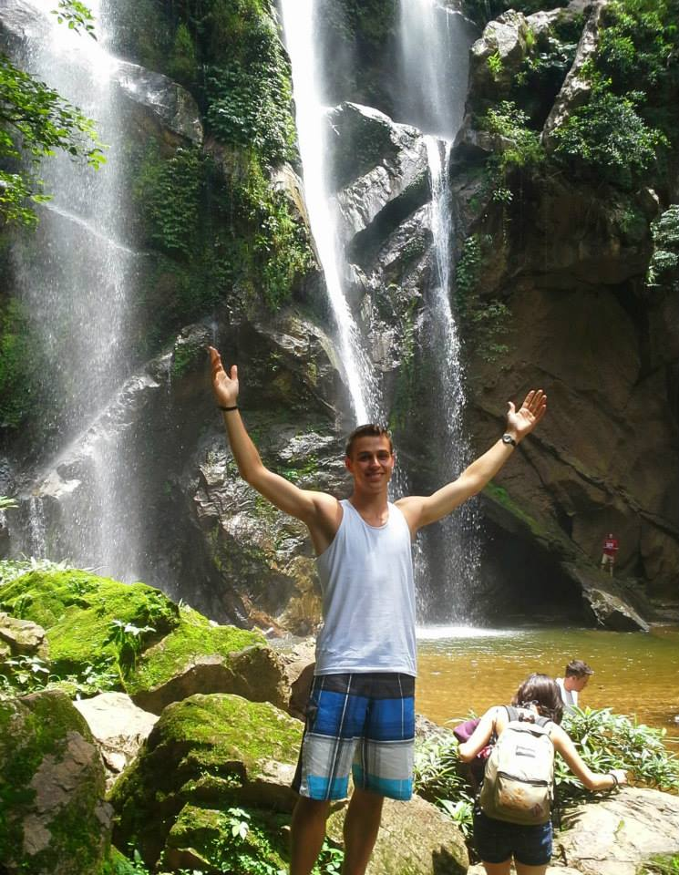 Student in front of waterfall in Chaing Mai Thailand