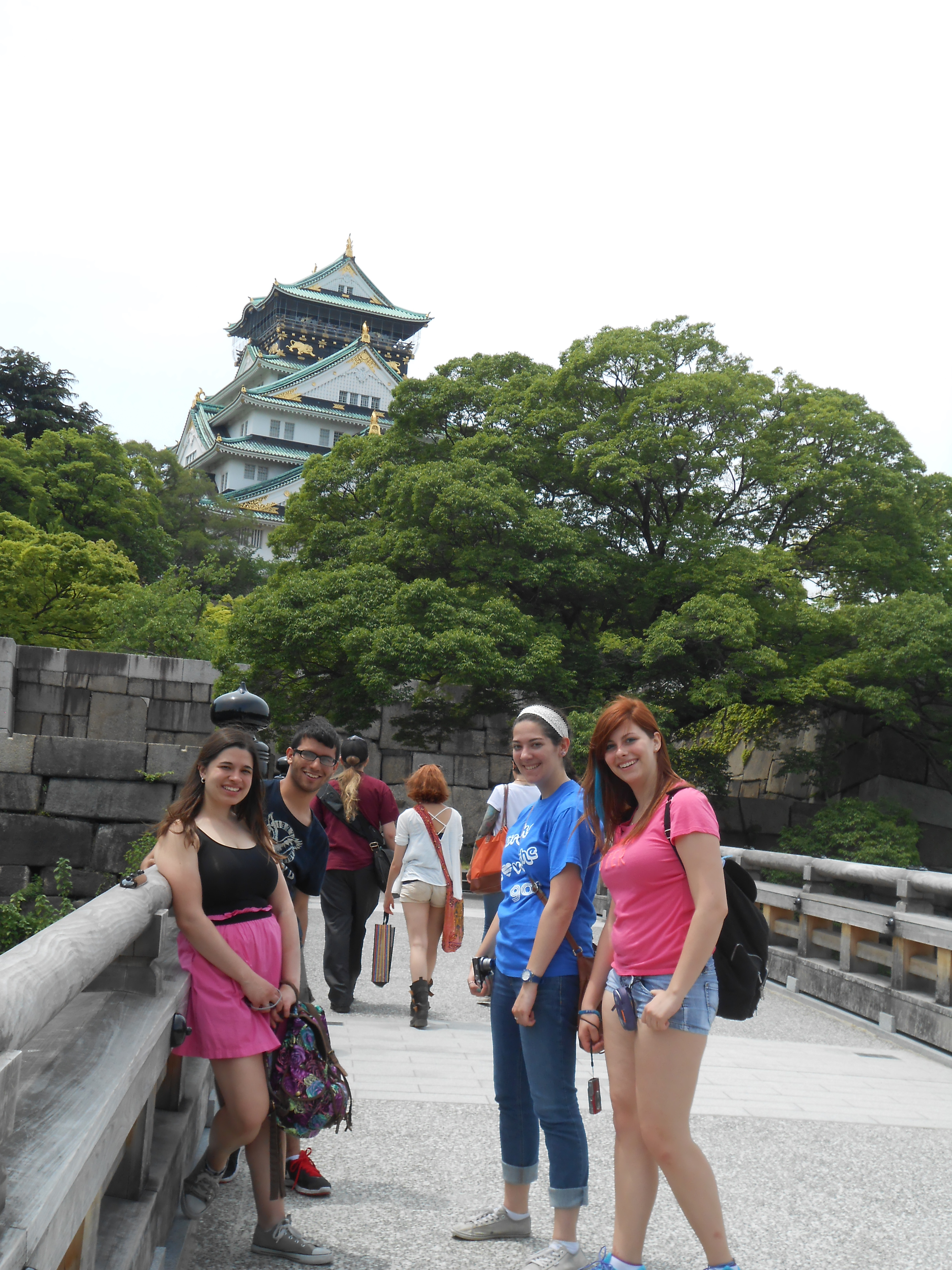 Students on bridge in front of Japanese castle