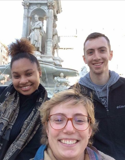Three students in front of statue in Lyon France