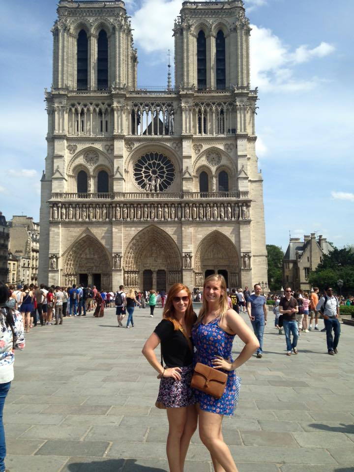 Two students in front of Notre Dame