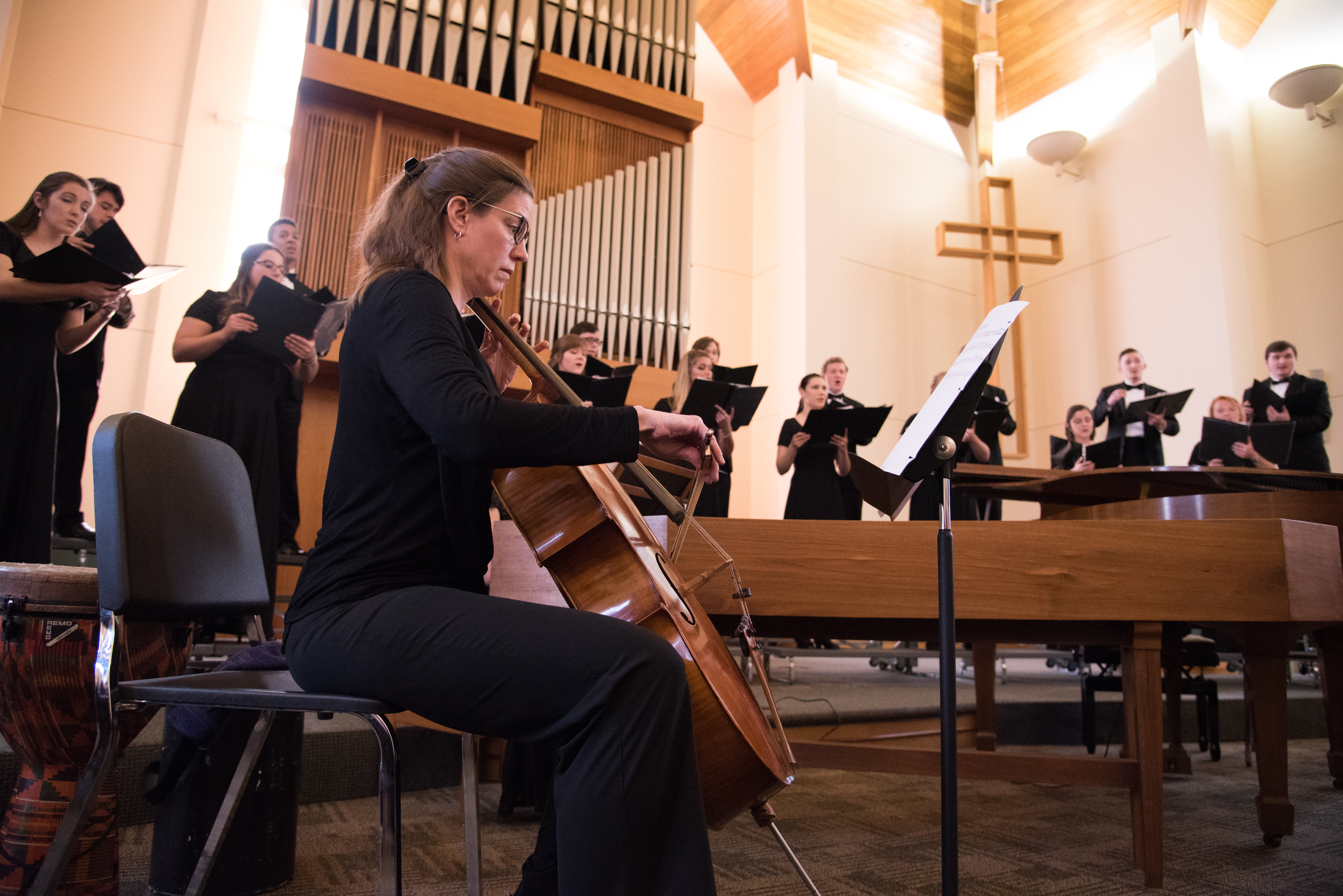 Cellist playing with choir