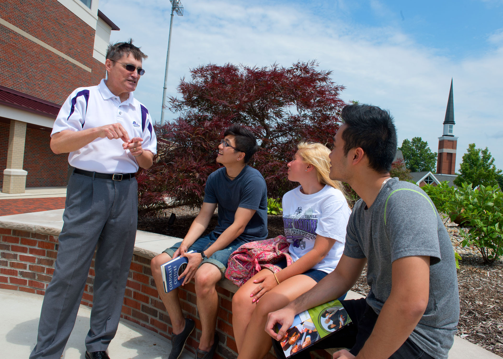 University of Mount Union students and professor outside