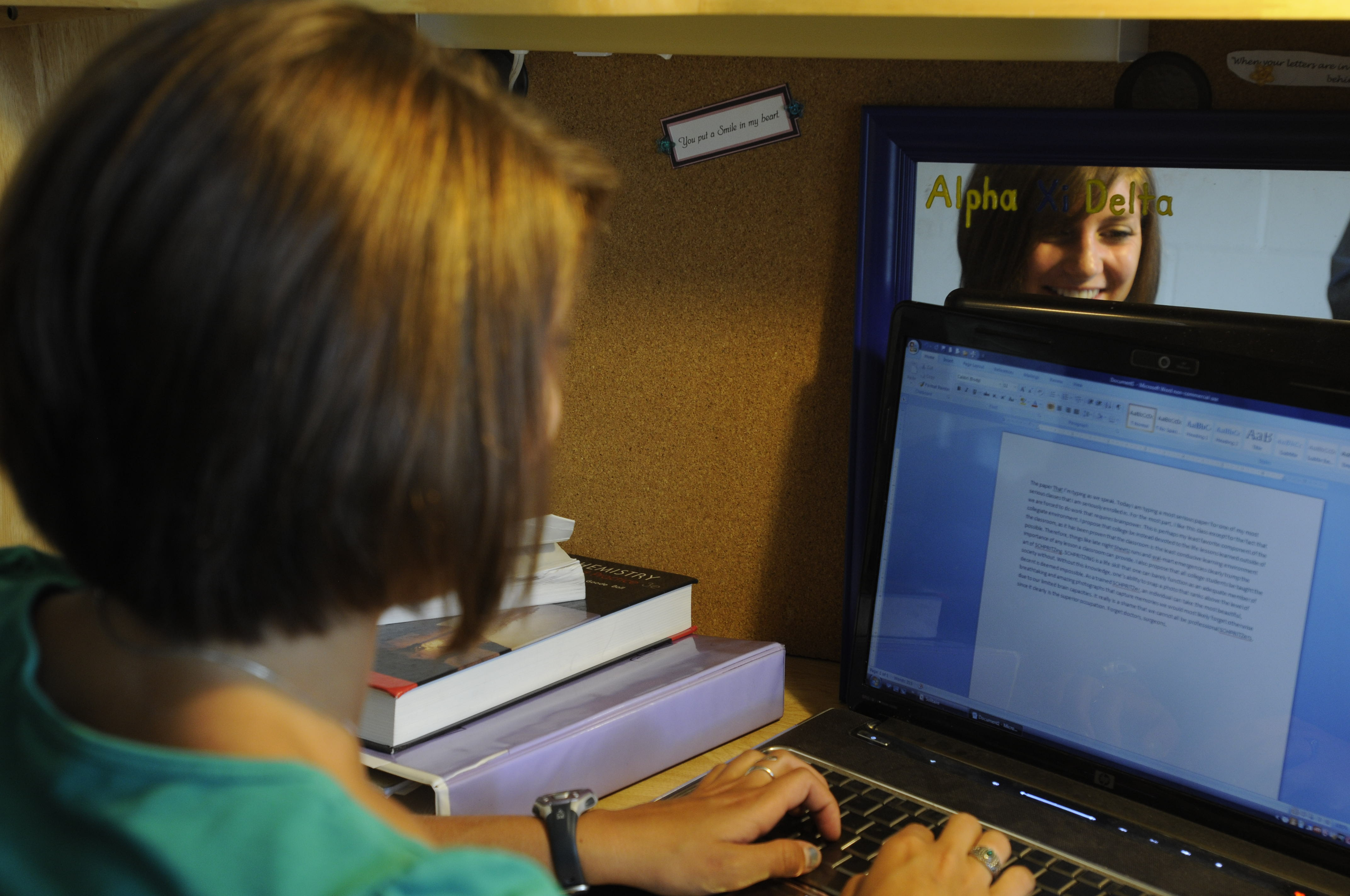 Student on laptop in residence hall room