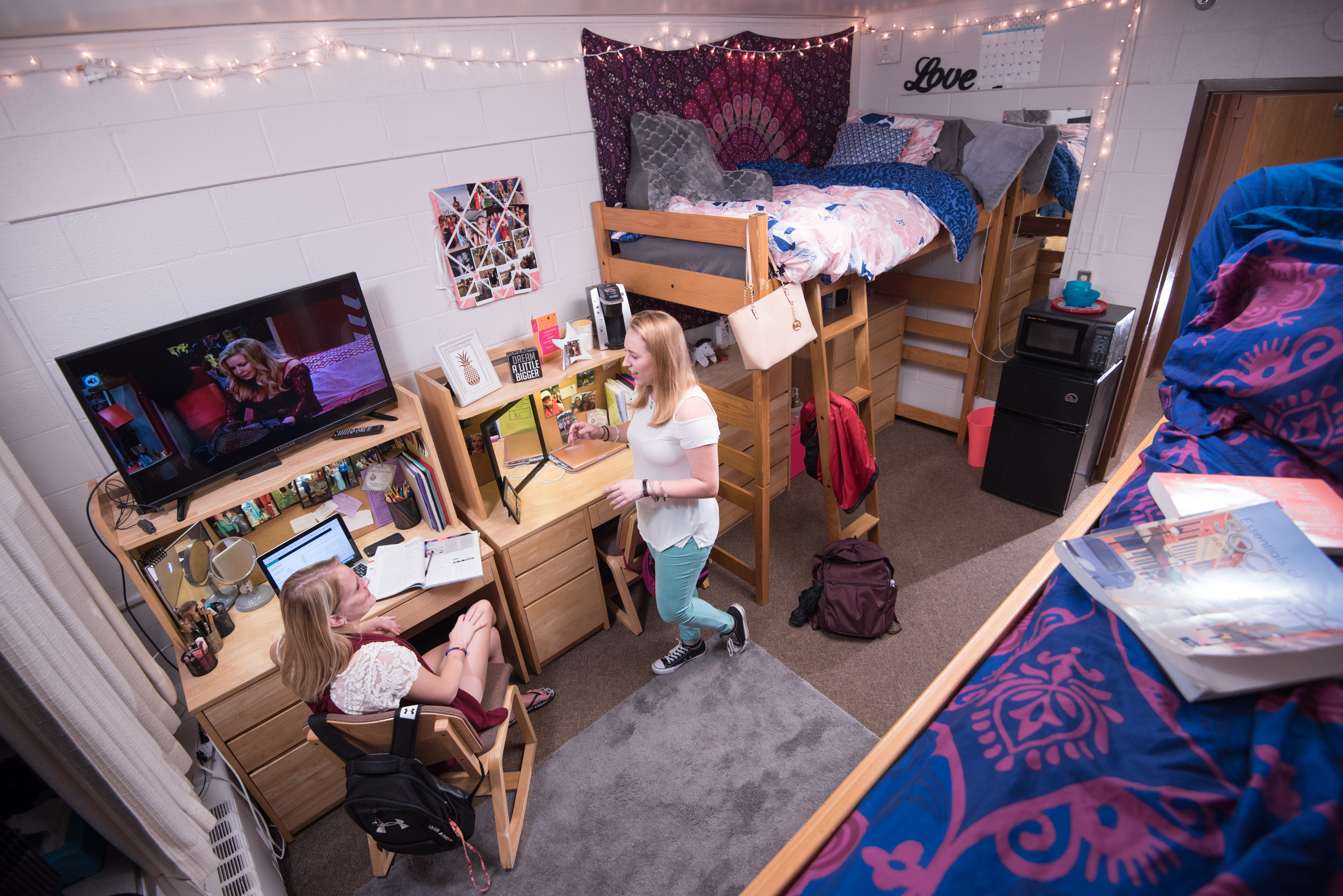 Students gathering in a residence hall room