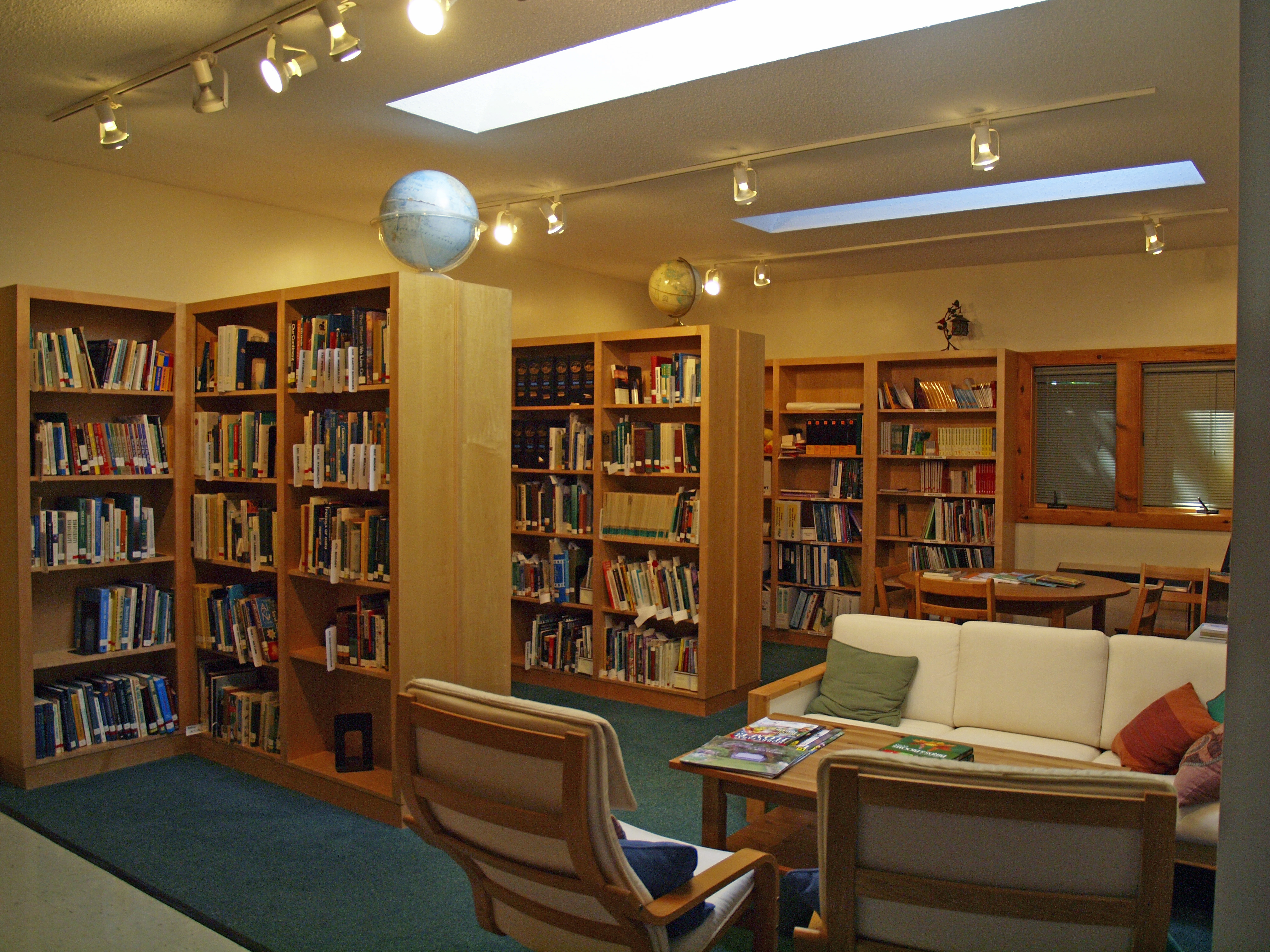 A study space with bookshelves and couches located in the Nature Center