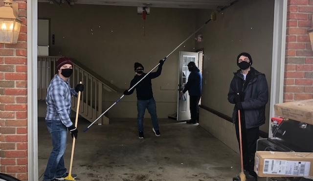 students cleaning garage