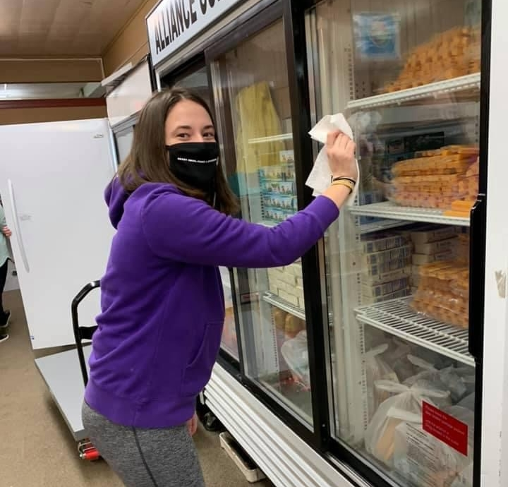 student cleaning pantry