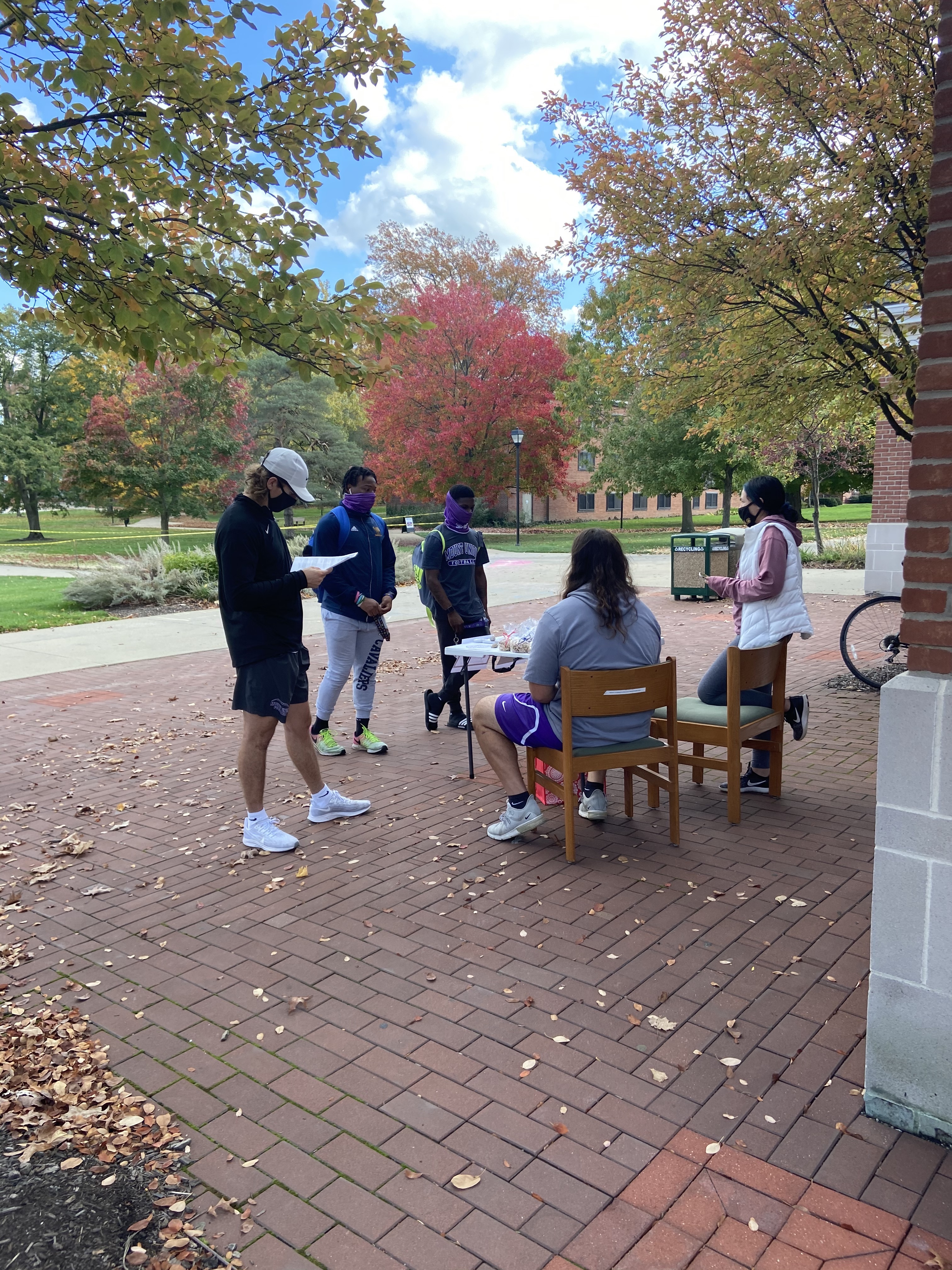 students registering to vote on campus