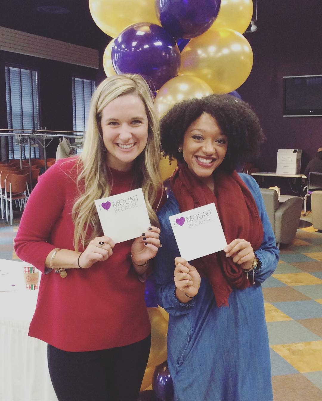 The Mount Union Fund's Bethany Leslie and Caitie Shimp displaying I Love Mount Union notes during Philanthropy Week 2018