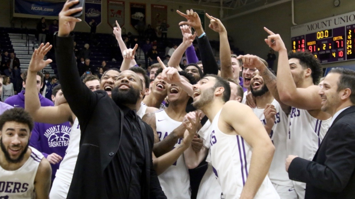 Mount Union basketball team celebration with Mike Gregg