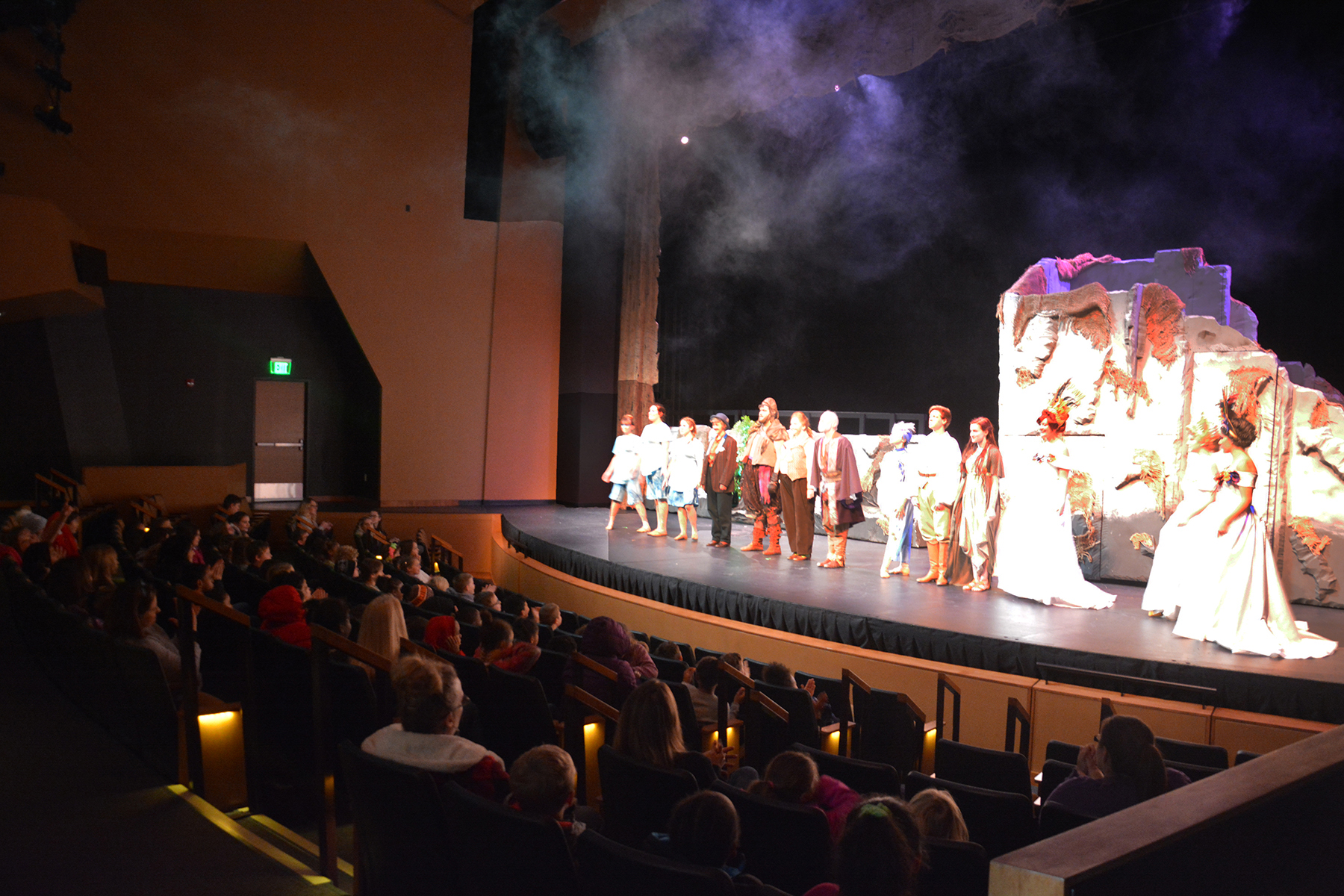wide shot of students clapping for the cast of Prospero's Magic Island