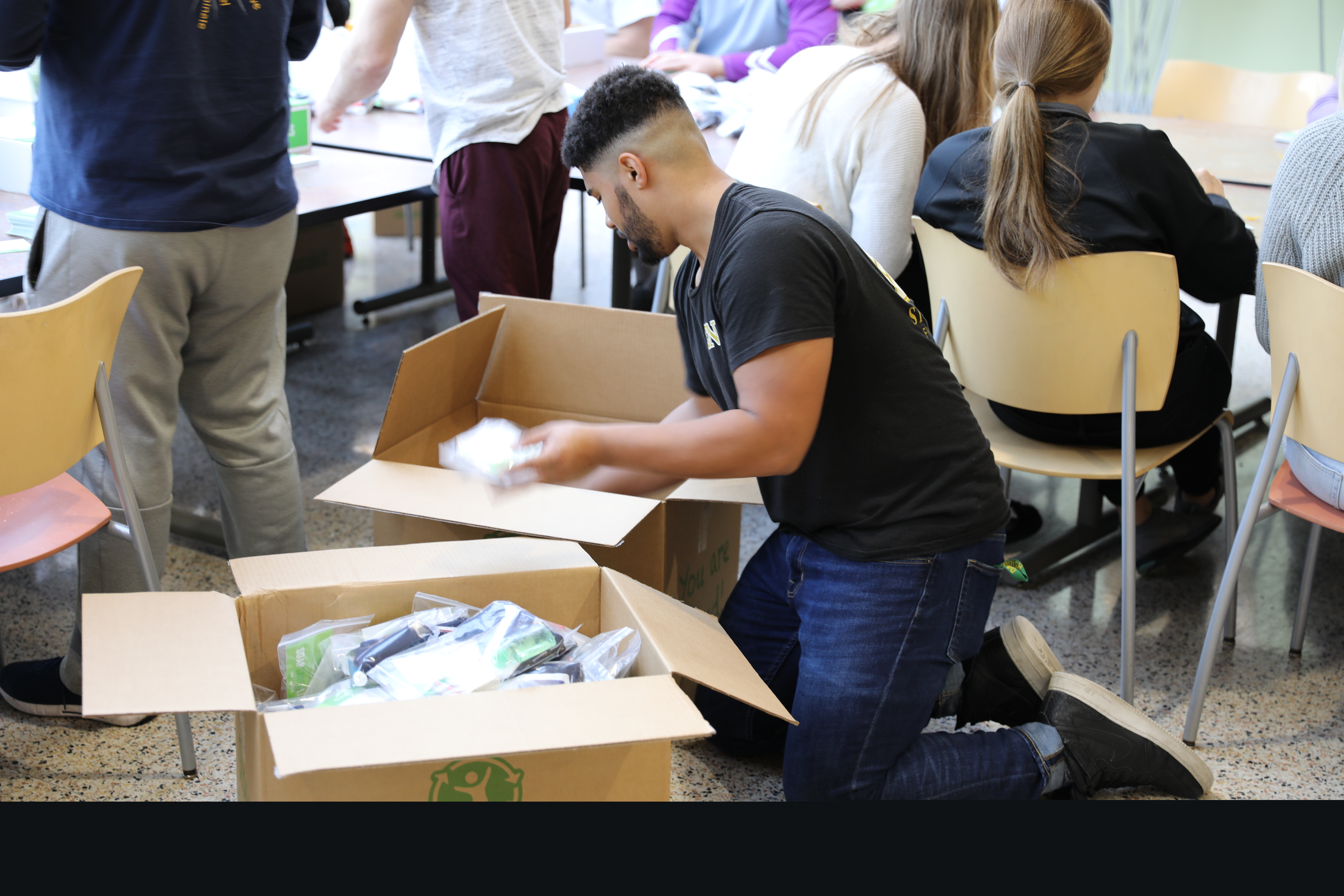 Student packing hygiene kits