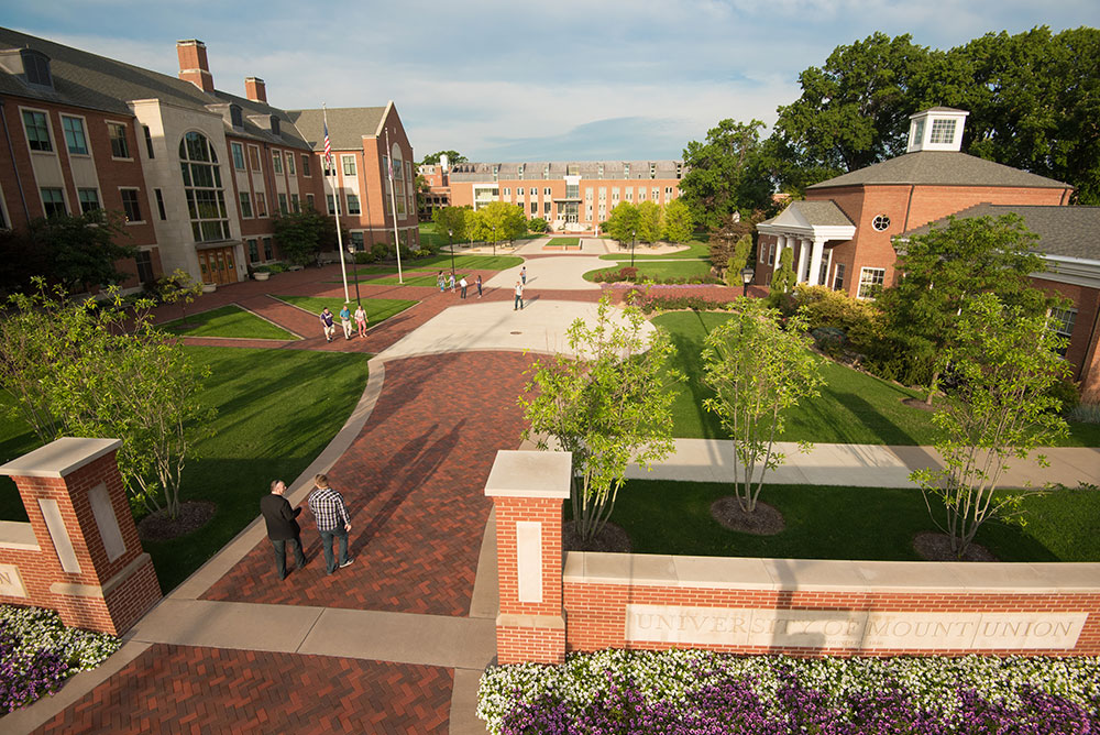 Mount Union brick path between brick buildings and green spaces